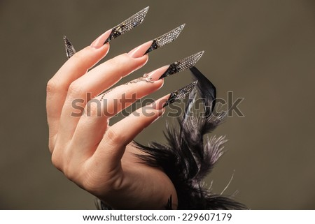 Female hand with manicure - stock photo