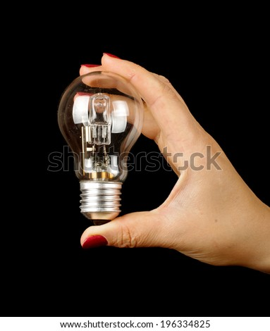 Female hand with manicure holding electric lamp - stock photo