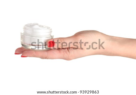 Female hand with manicure keeping cream on palm isolated on white - stock photo