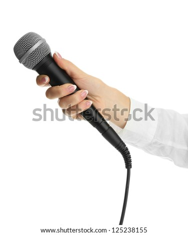 female hand with microphone isolated on white - stock photo