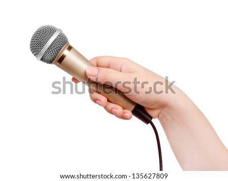 Female hand with microphone, on white background. - stock photo
