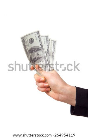 Female hand with money isolated on a white background - stock photo