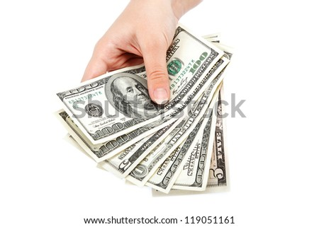 Female hand with money isolated on a white background. Dollar bills.