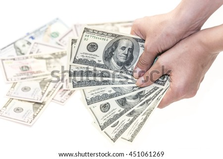 Female hand with one hundred dollars banknotes - stock photo