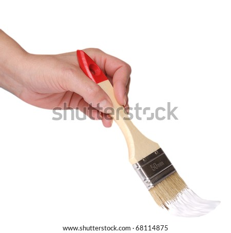 Female hand with paintbrush isolated over white