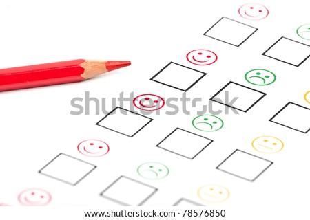 female hand with red pencil choosing positive or negative. customer satisfaction - stock photo