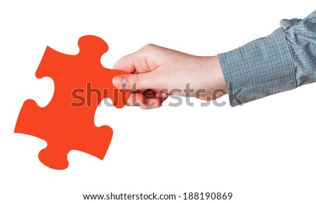 female hand with red puzzle piece isolated on white background