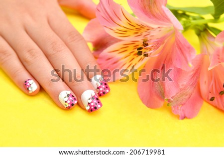 Female hand with stylish colorful nails, on bright background  - stock photo