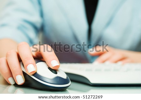 Female hand working on computer. - stock photo