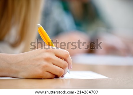 Female hand writing, close up  - stock photo