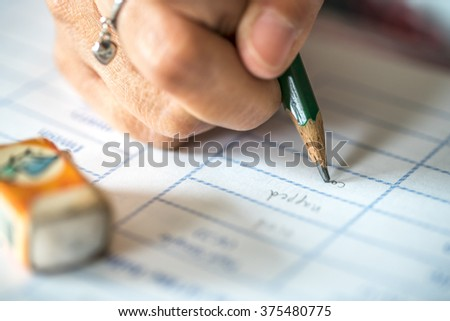 Female hand writing, close up