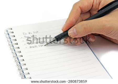 female hand writing to do list lying isolated on pure white background