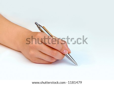 Female hand writing with a ball point pen on white paper background