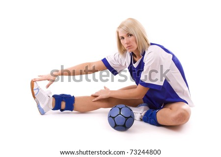 female handball player with a used ball make exercise - stock photo