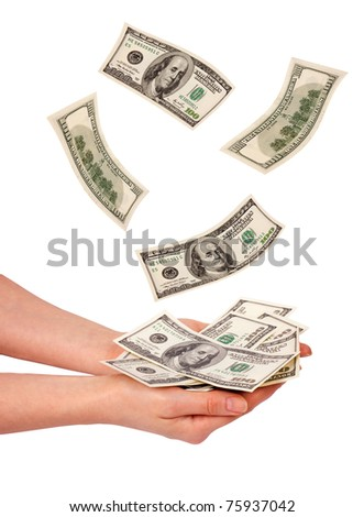 Female hands and falling money isolated on white background