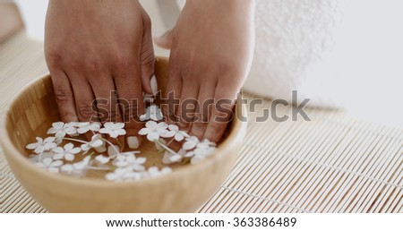 Female Hands And Manicure In Spa Salon - stock photo