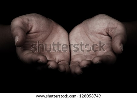 Female hands as if holding something. - stock photo
