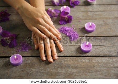 Female hands at spa manicure procedure