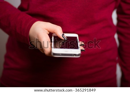 female hands click on the touchscreen phone - stock photo