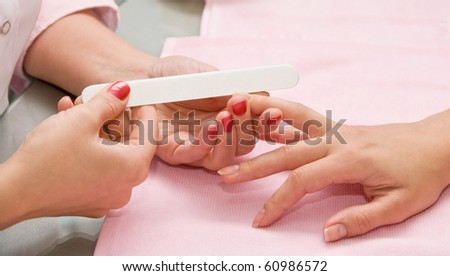 Female hands closeup at manicure process