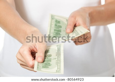 Female hands counting money, focus on front dollar - stock photo