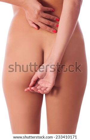 female hands covering naked buttocks and loin, back pain, healthcare concept