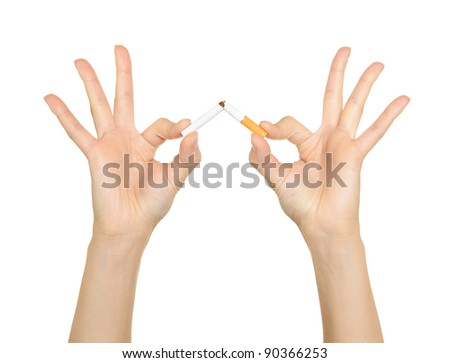 Female hands crushing cigarettes isolated on white background - stock photo