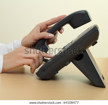 Female hands dialing phone number - stock photo