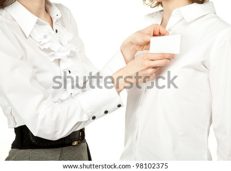 Female hands fastening badge; studio shot illustrating conference/business meeting - stock photo