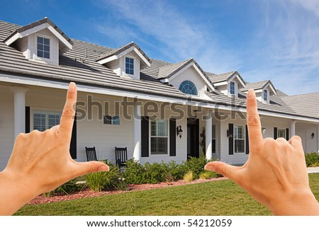 Female Hands Framing Beautiful House Over Blue Sky. - stock photo