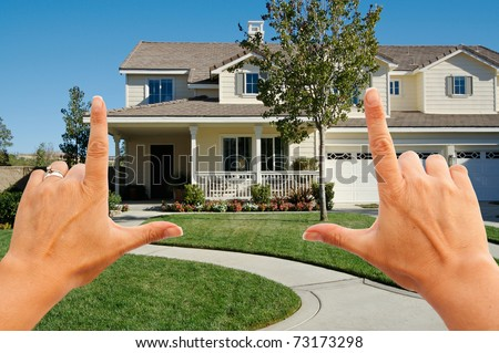 Female Hands Framing Beautiful Newly Constructed House. - stock photo