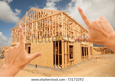 Female Hands Framing New Home Frame on Construction Site. - stock photo
