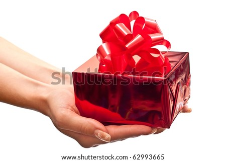 Female hands giving a christmas gift. Isolated on white - stock photo