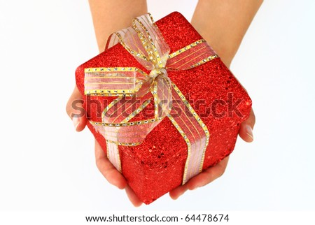 Female hands giving a christmas gift isolated on white - stock photo