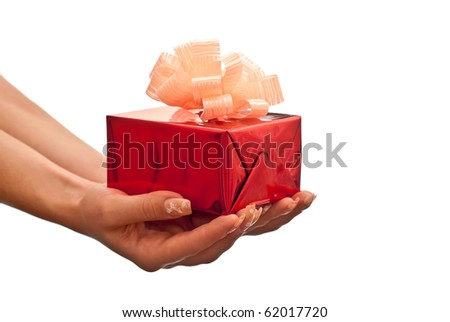 Female hands giving a christmas gift. Isolated on white background - stock photo
