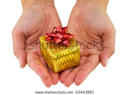 Female hands giving a small christmas gift isolated on white - stock photo