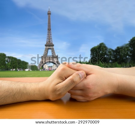 female hands grasping a man in concept of love in Paris