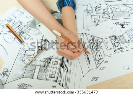 Female hands help paint the baby - stock photo