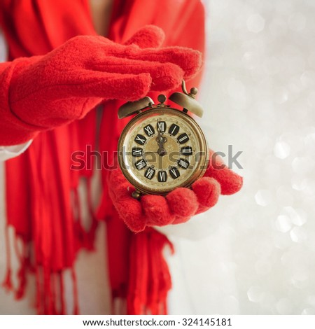 Female hands holding a alarm clock - stock photo