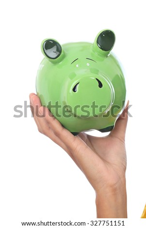 Female hands holding a piggy bank
