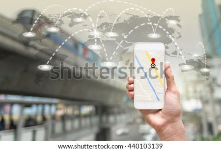 female hands holding a smart phone showing part of navigator map on connection line over the world map with blurred photo of traffic jam, Navigation concept,Elements of this image furnished by NASA - stock photo