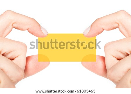 Female hands holding and showing semi-transparent orange blank business card (close-up)