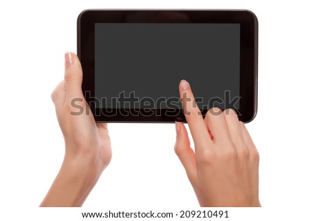 Female hands holding and touching android digital tablet computer with empty screen and copyspace, isolated on white background.