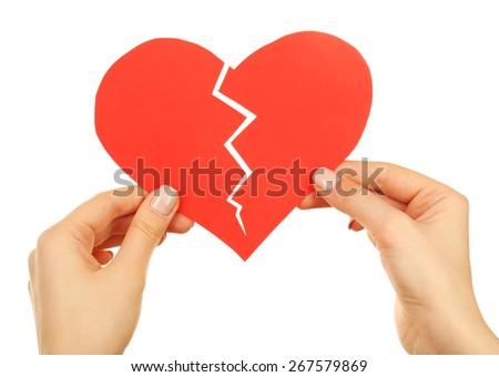 Female hands holding broken heart isolated on white - stock photo