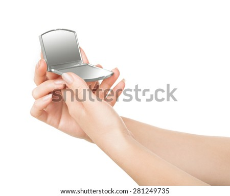 female hands holding cosmetic mirror