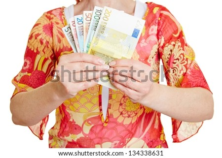 Female hands holding different Euro money banknotes - stock photo