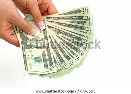 Female hands holding 20 dollar banknotes