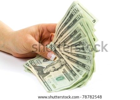Female hands holding 20 dollar banknotes - stock photo