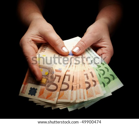 female hands holding european paper currency - stock photo