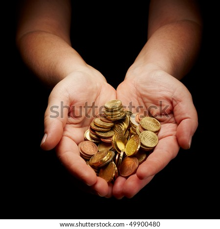 female hands holding european union coins - stock photo
